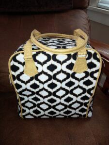 black white and gold bag