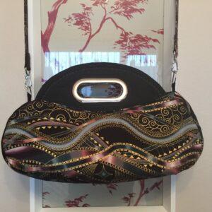 made by Celia O. Celia chose to put a solid black on the sides which I think looks really nice!