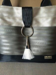 another example of the sleek drop tassel on a medium bag
