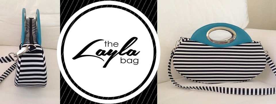 black and white oval handbag with blue handles