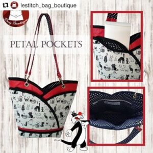 black, white and red tote bag with cat themed fabric