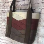 large tote hanging against brick wall