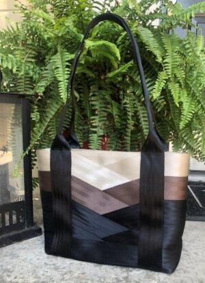 seat belt bag in neutral tones on front porch