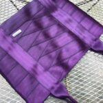 purple seat belt bag laying on table
