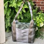 tote sewn with griege and army colored seat belts on porch