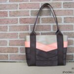 main view of seat belt bag in sand coral reef and rich cocoa seat belts