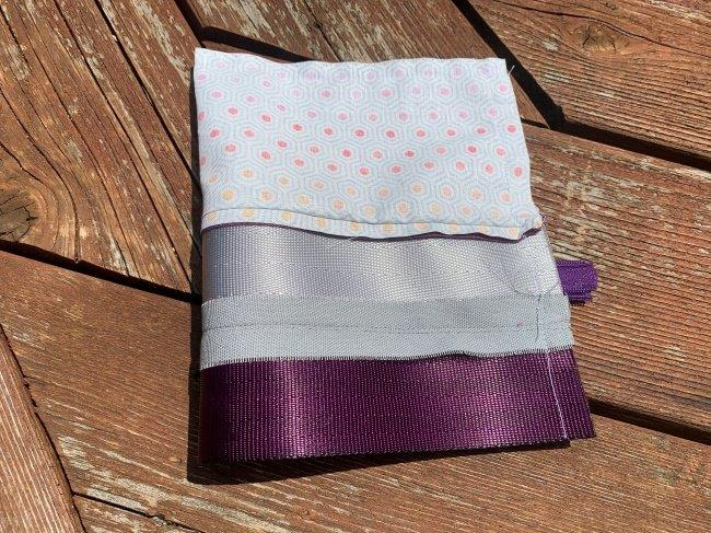 Edges of exterior and lining of pouch are stitched together around all edges