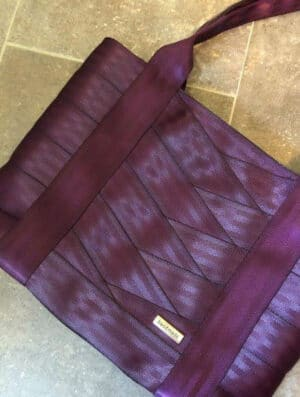 tote sewn with purple seat belt webbing